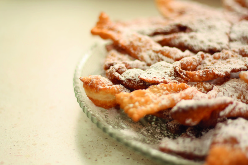 Bugnes, light fritters, are commonly eaten during Mardi Gras.