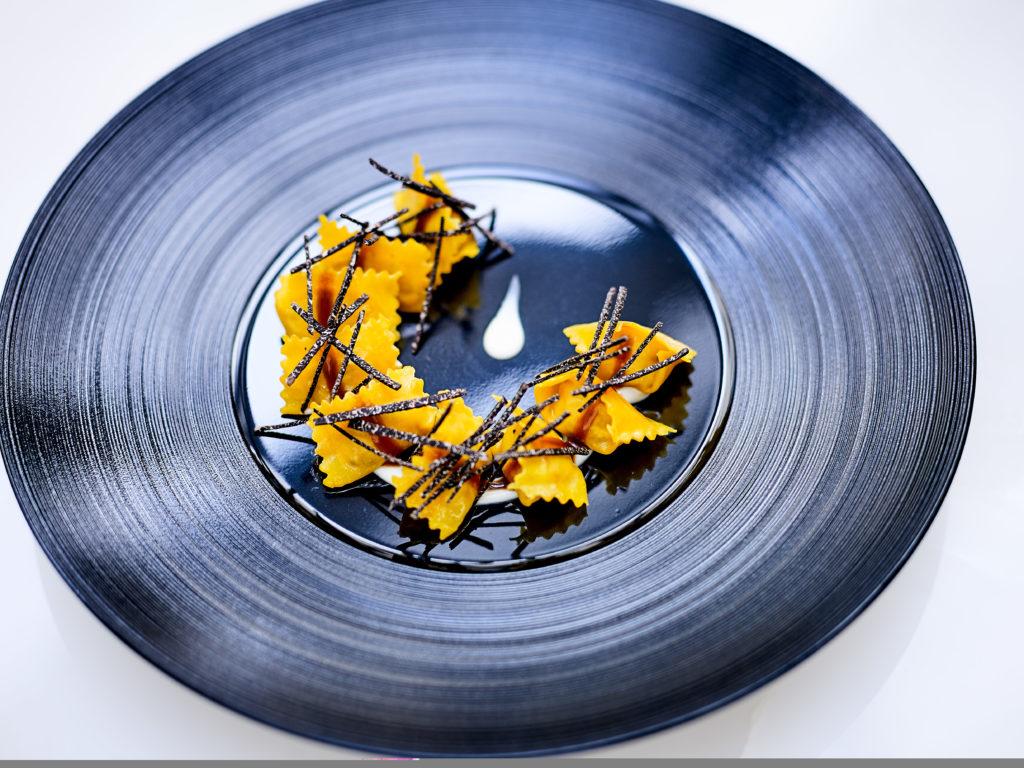 Ravioli del plin with black truffle and parmesan cream