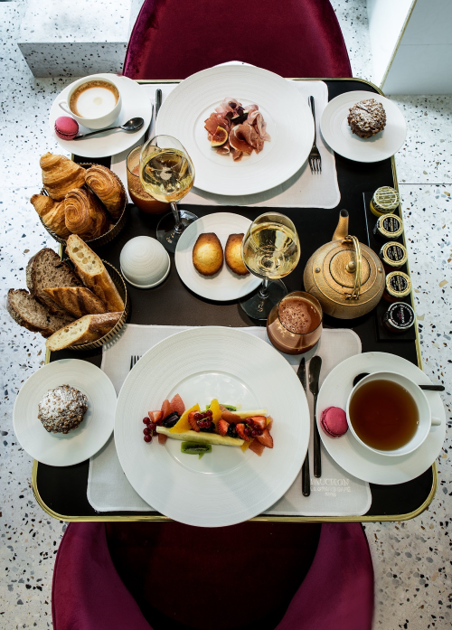 Breakfast cart at Fauchon L'Hôtel Paris with breads and fruits