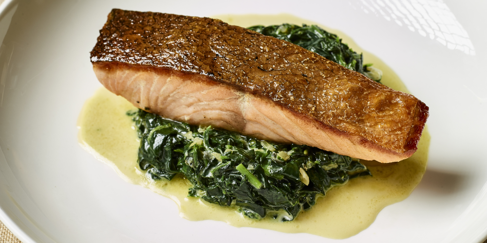 Pan-fried salmon with spinach, watercress and Saint Agur blue cheese sauce