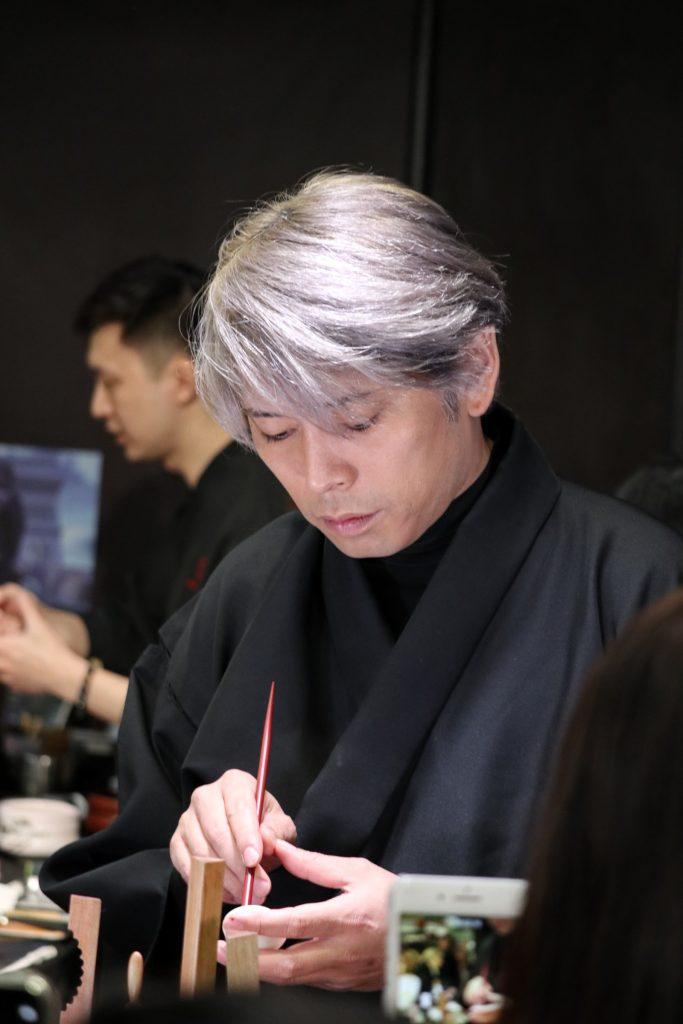 Junichi Mitsubori demonstrating wagashi