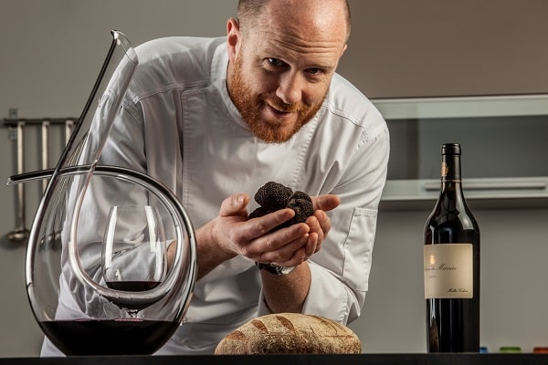 Chef with black truffles