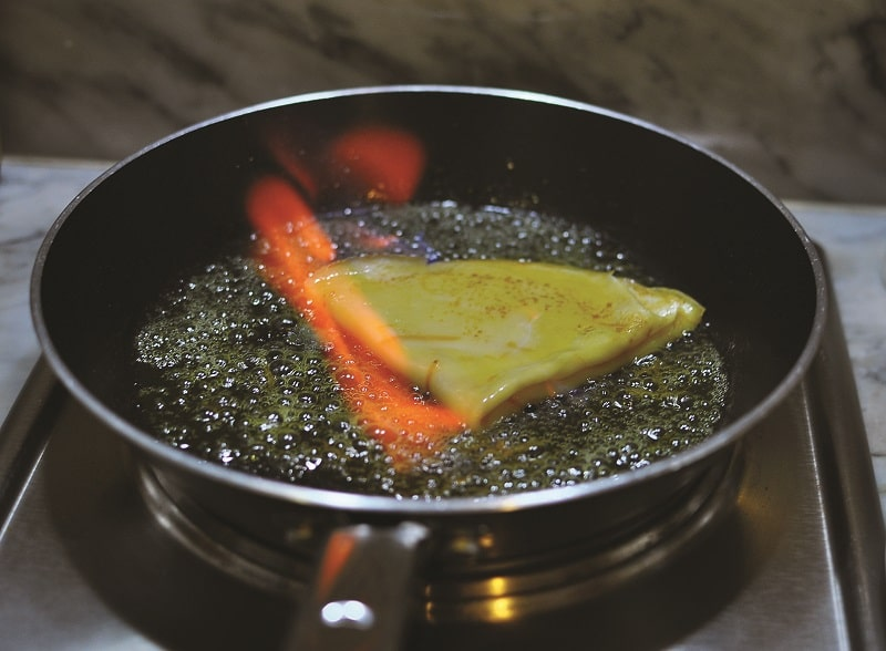 Sizziling crepe in pan