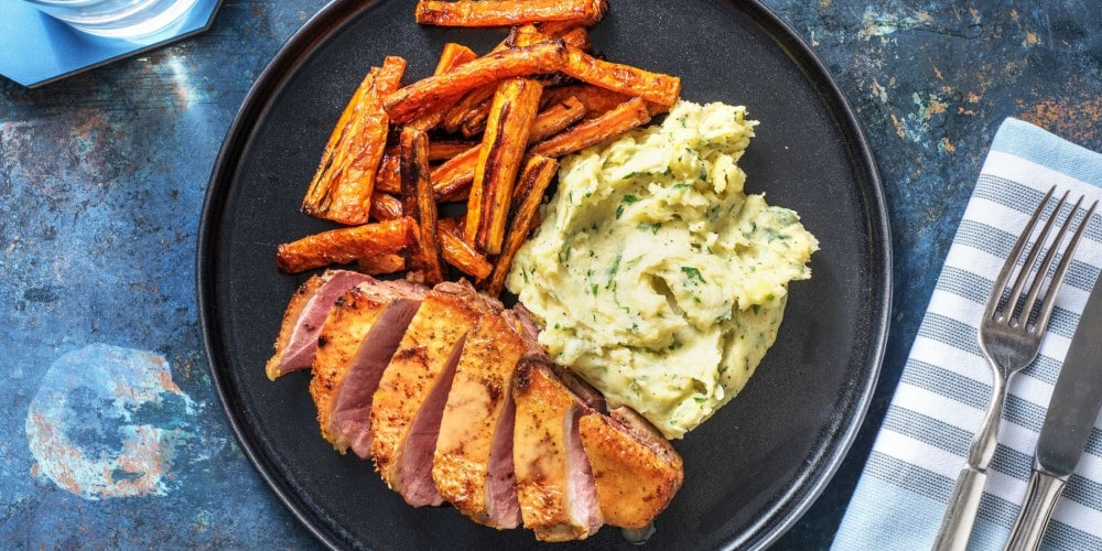 Duck à l'orange with parsley mash and roasted carrots