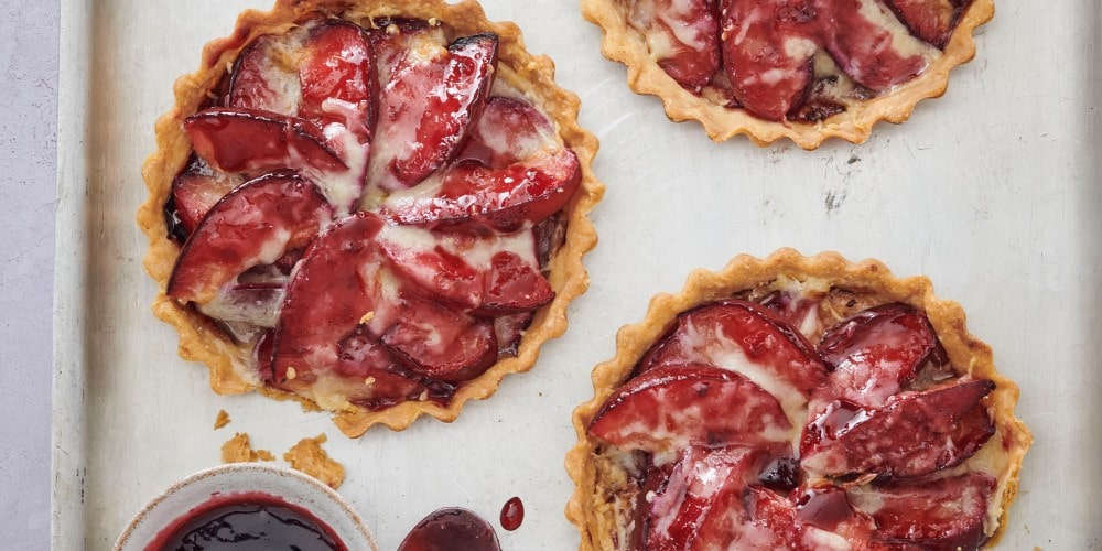 Comté, plum & cherry tartlets
