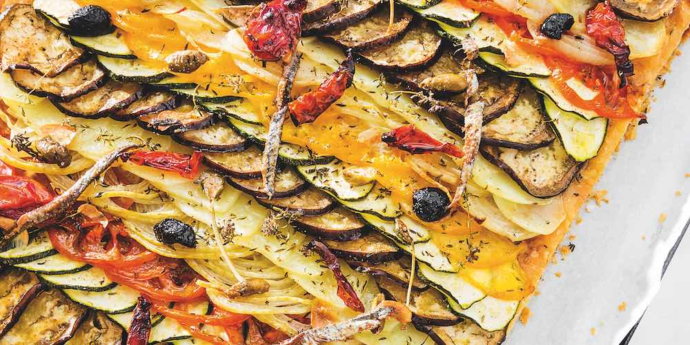 Puff pastry topped with anchovy bayaldi
