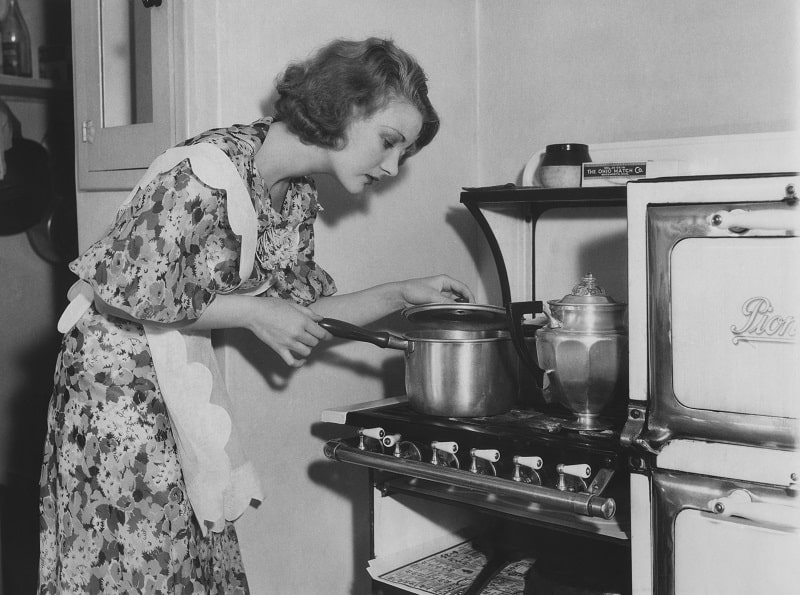 Black and white image of housewife cooking