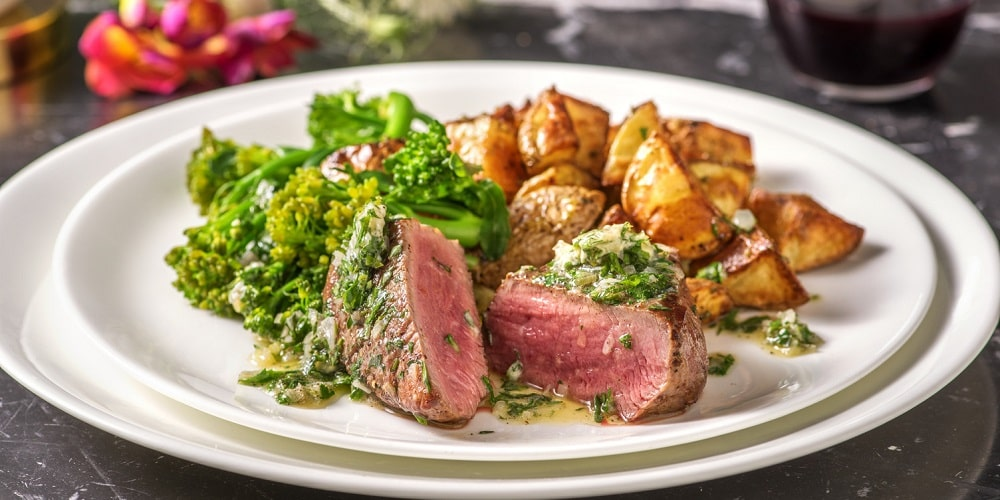 Sirloin steak and bearnaise butter with roasties and tenderstem broccoli