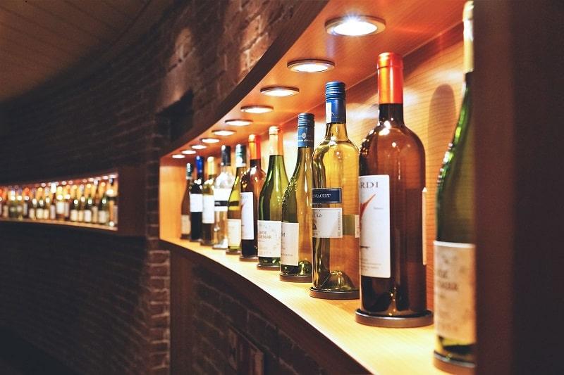 Wines on a lit shelf