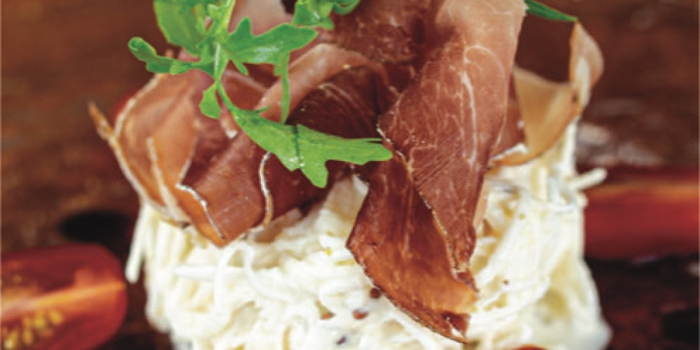 Remoulade of celeriac with Savoie ham and basil oil