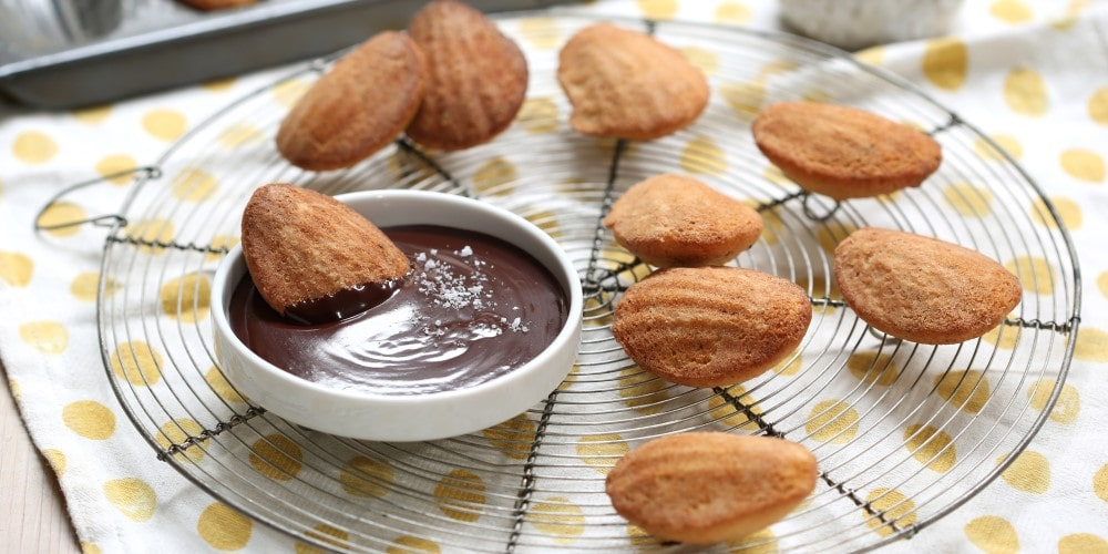 Warm madeleines with chocolate dipping sauce